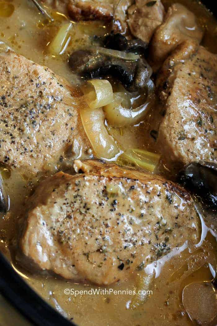 slow cooker pork chops cooked with mushrooms and onions all day until fork tender!