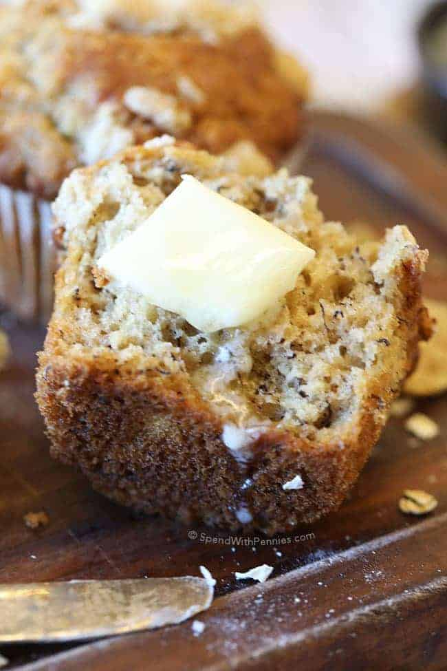 Banana Pecan Crunch Muffins with a pat of butter on it