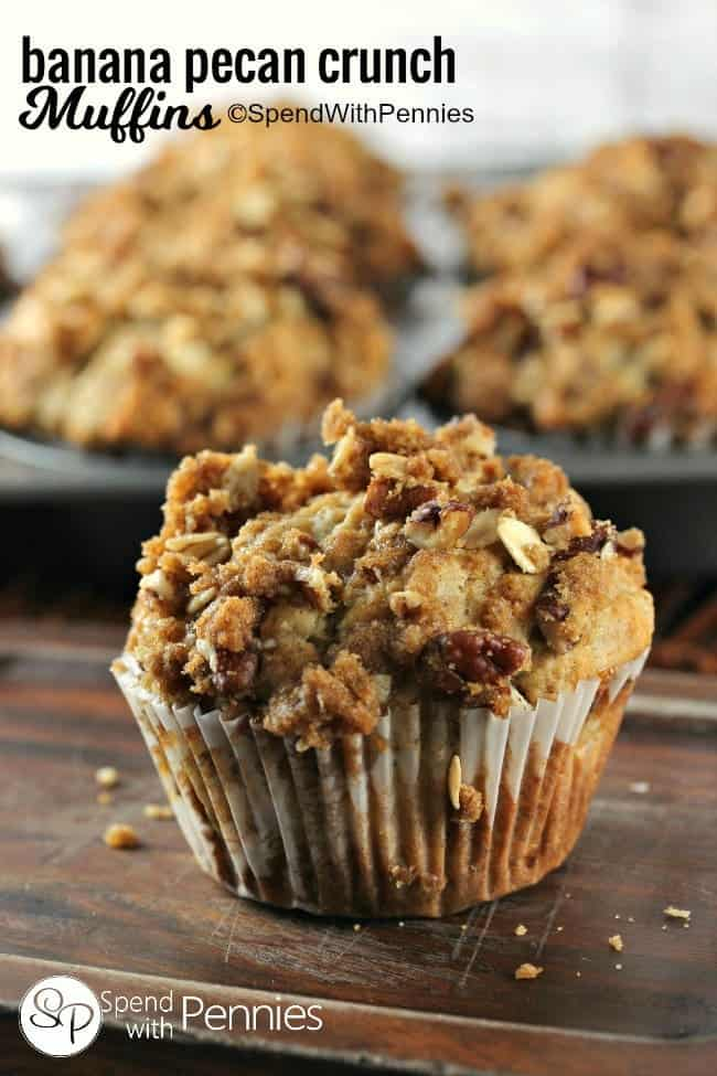 a Banana Nut Muffin with crunchy topping with a pan of muffins in the background