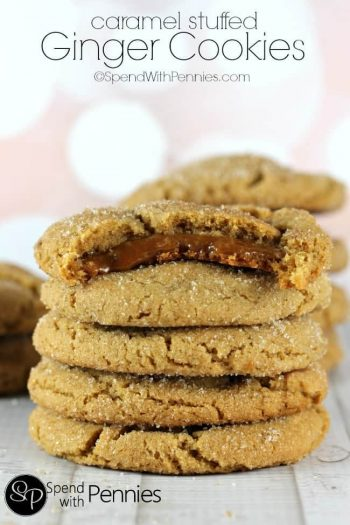 Caramel Stuffed Ginger Cookies in a stack with a bite out of the top one