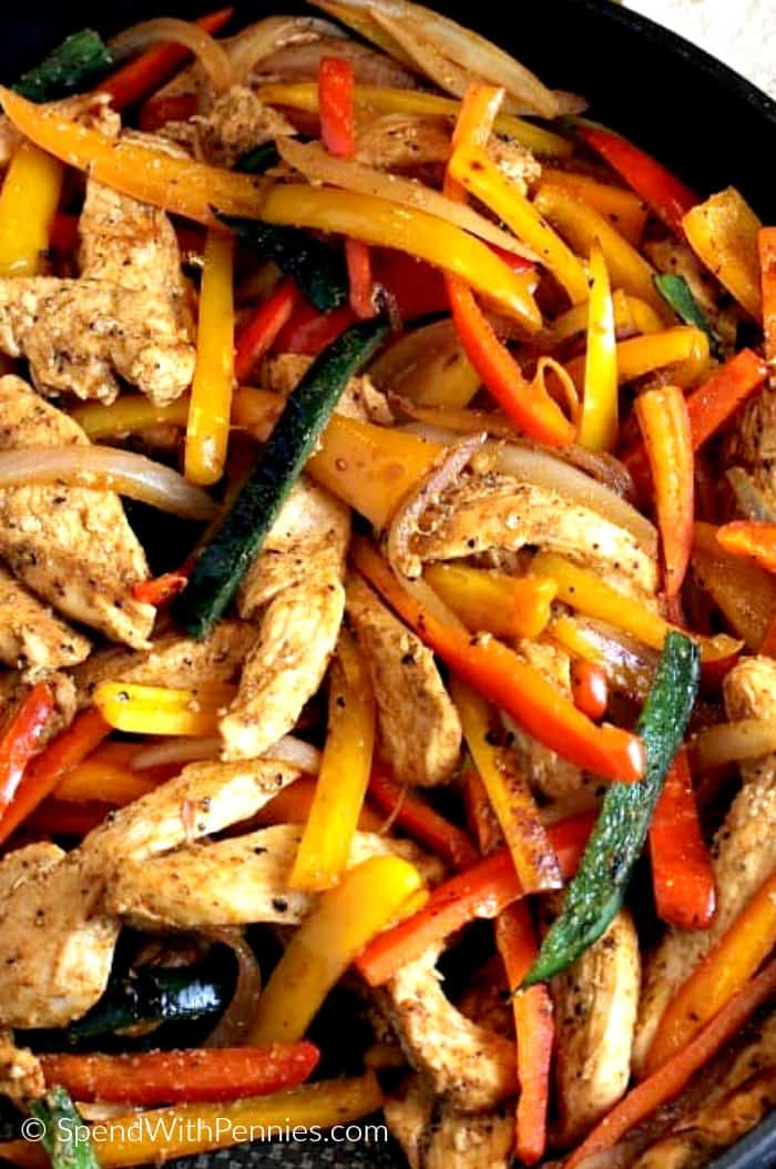 Chicken Fajita filling in a frying pan with peppers and onions.