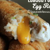 close up of loaded potato egg rolls, with cheese oozing out of one