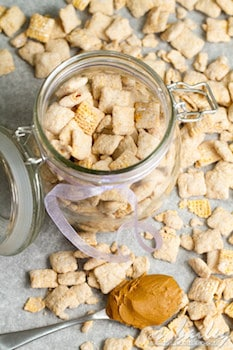 cookie butter puppy chow, with some in a jar, with cookie butter on a spoon
