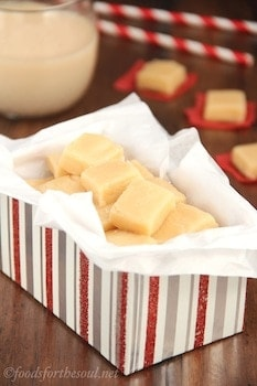 squares of eggnog fudge in a box