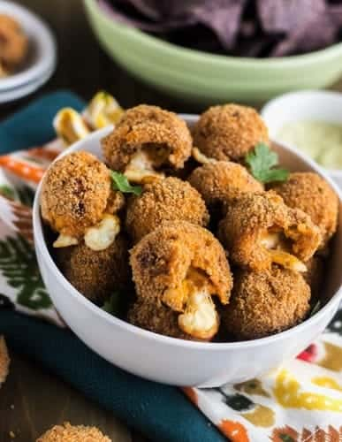 crispy cheesy buffalo chicken potato poppers in a bowl