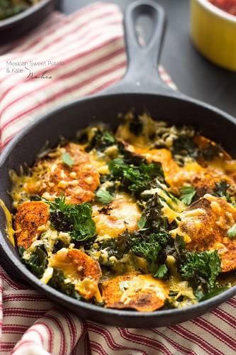 kale nachos with cheese in a skillet