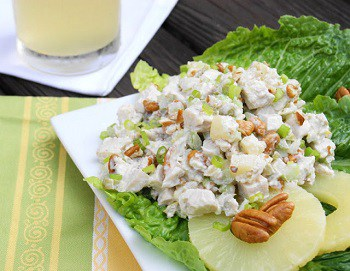 pineapple pean chicken salad on lettuce and pineapple slices