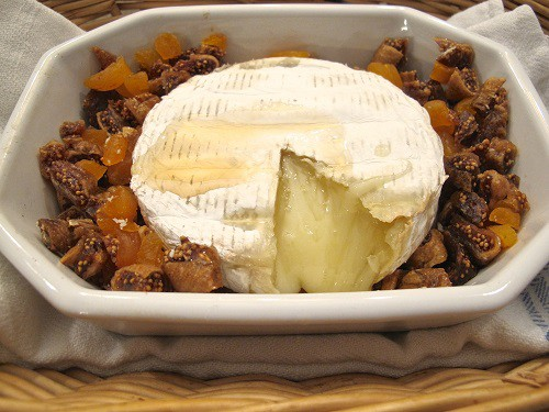 baked brie with apricots in a white dish