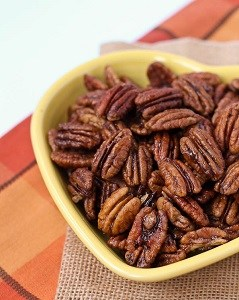 candied pecans in a yellow bowl