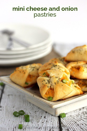 mini cheese and onion pastries on a plate