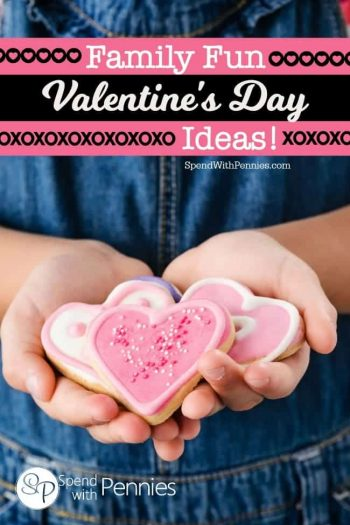 girl holding heart shaped cookies
