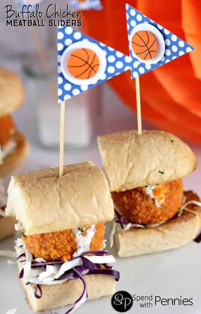 Buffalo Chicken Meatball Subs!  Like Buffalo Wings? You'll LOVE these!! Tender chicken meatballs baked crispy in the oven, rolled in buffalo sauce & topped with dip!  These can be served as buffalo chicken sandwiches or sliders! Bring on March Madness!