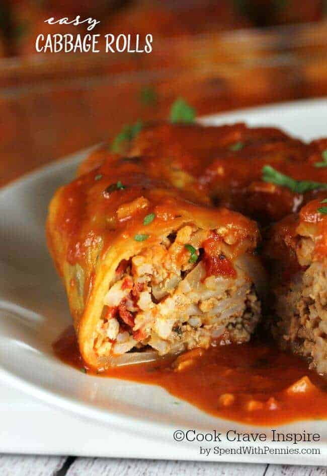 These easy cabbage rolls are the perfect comfort dish! Cabbage leaves stuffed with seasoned beef, pork & rice and baked in a delicious tomato sauce.