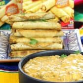 Cheesy Taquito Beef Queso Dip made with seasoned ground beef and tons of cheese