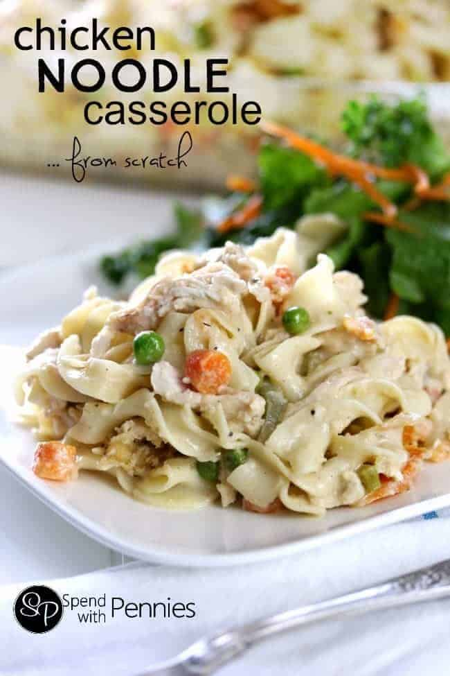 A serving of chicken noodle casserole with peas and carrots
