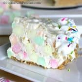 a slice of rainbow pie with colorful marshmallows and sprinkles