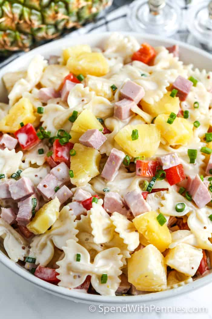 close view of pasta salad with ham and pineapple
