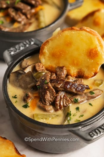 Cheesesteak Soup in a bowl with cheese bread