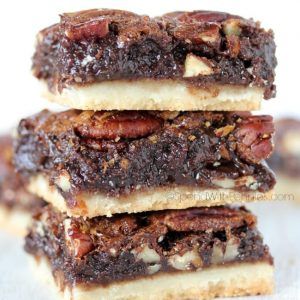 Chocolate Pecan Pie Bars are one of our favorite treats! A shortbread crust topped loaded with gooey pecan filling, these squares are rich & chocolatey !