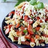 Pizza Pasta Salad garnished with basil in a bowl