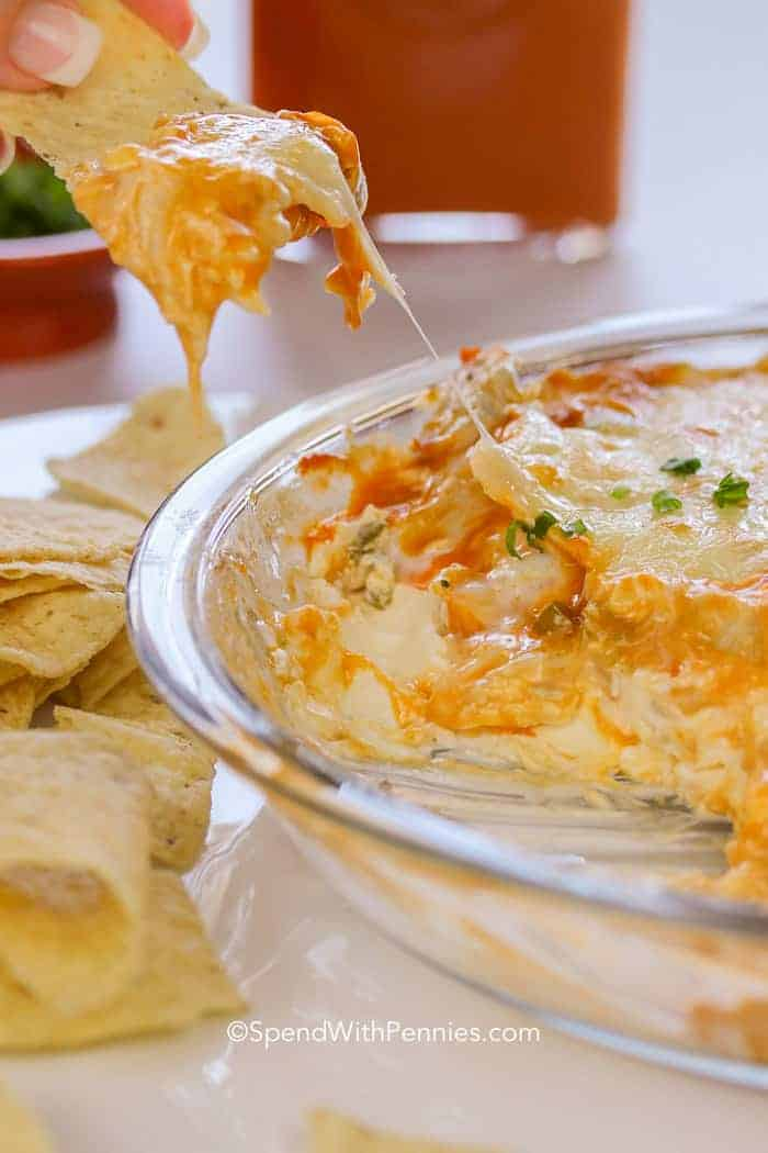 Buffalo Chicken Wing Dip being scooped out of a bowl with cheese