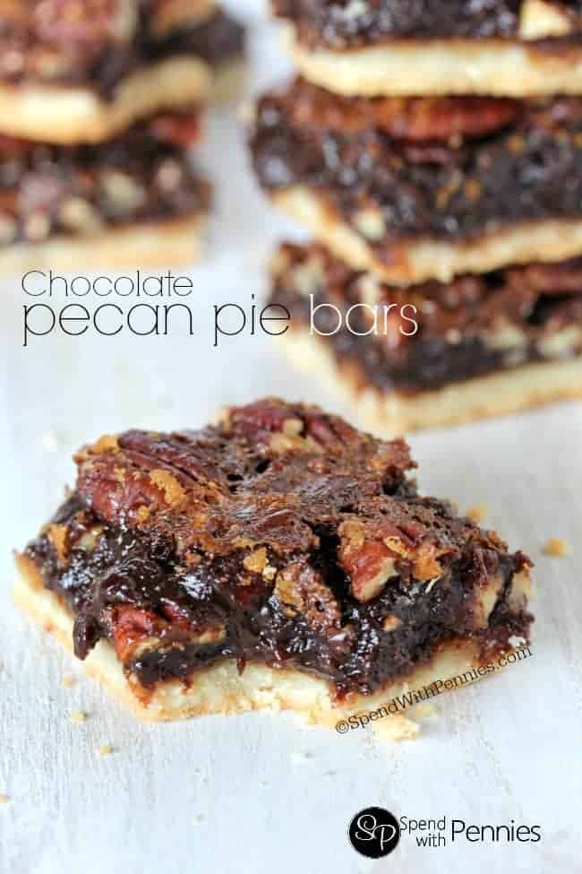 Chocolate Pecan Pie Bars are one of our favorite treats! A shortbread crust topped loaded with gooey pecan filling, these squares are rich & chocolatey!