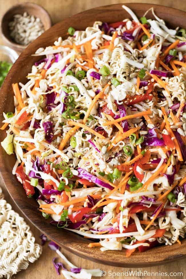Ramen Noodle Salad is a potluck favorite! Crisp cabbage, bean sprouts, shredded carrots and ramen noodles are tossed together for the perfect Oriental salad that everyone always loves! Top with sunflower seeds or toasted almonds for a delicious nutty crunch!