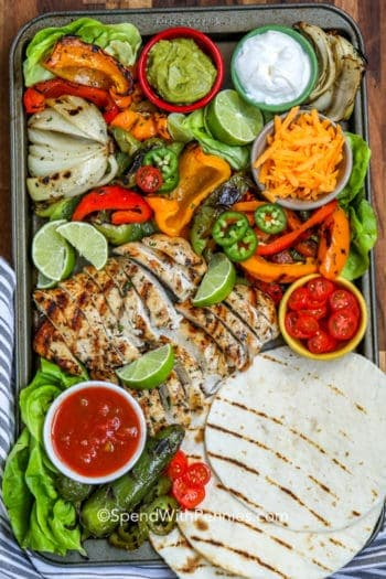 Baking sheet with ingredients for grilled chicken fajitas