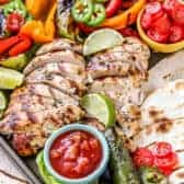 Grilled chicken fajita ingredients on a sheet pan
