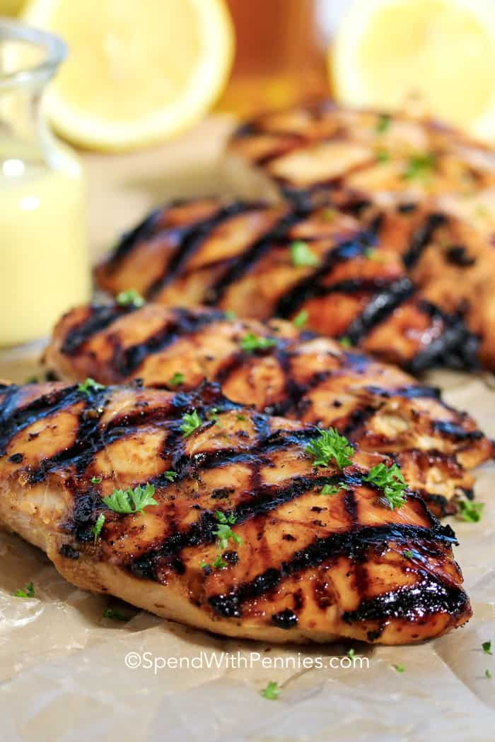 Grilled Honey Mustard Chicken on a board ready to serve with honey mustard sauce