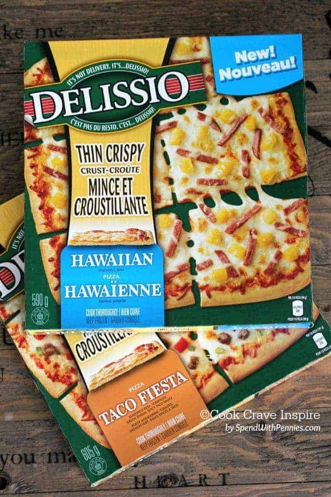 Delissio Thin Crust is perfect on the grill!  Hawaiian Chicken Grilled Pizza!  Total pizza perfection on the grill with ham and pineapple pizza topped with chicken & peppers! An easy appetizer or meal!