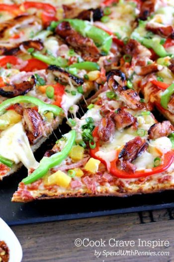 Grilled Hawaiian Chicken Pizza cut and being served