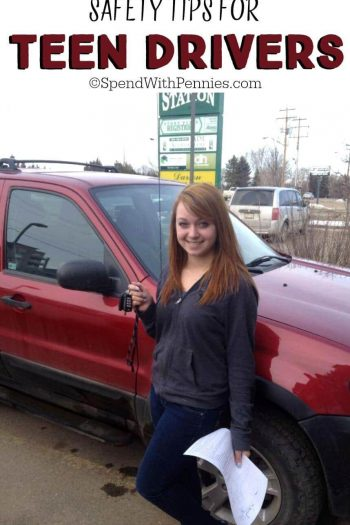 teen driver in front of a vehicle