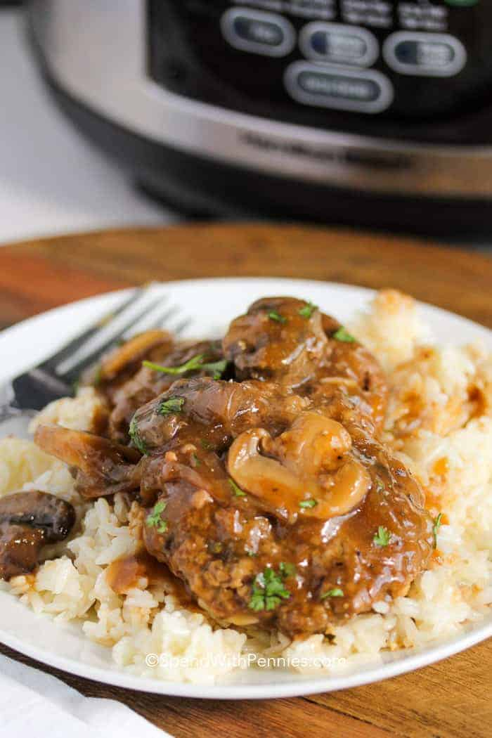 Crock Pot Salisbury Steak on a plate with rice