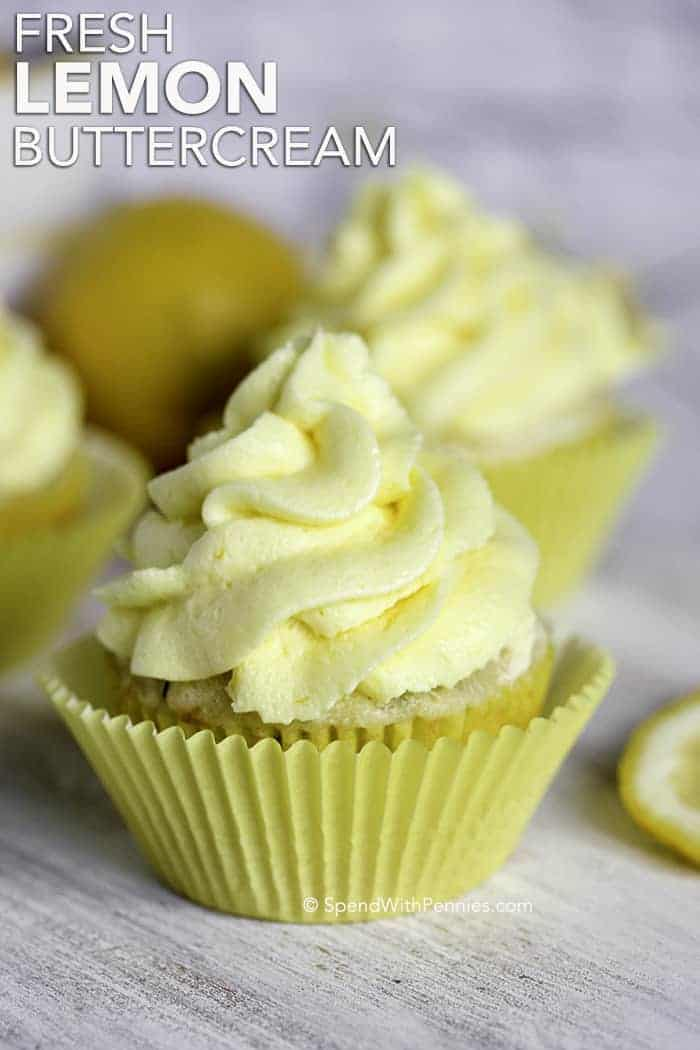 Cupcake with lemon frosting on top in a yellow cupcake holder