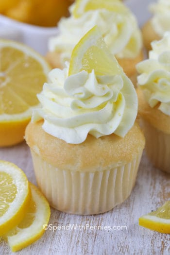Lemon Buttercream Frosting in a cupcake with a lemon wedge