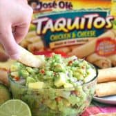 Pineapple Guacamole with taquitos and limes