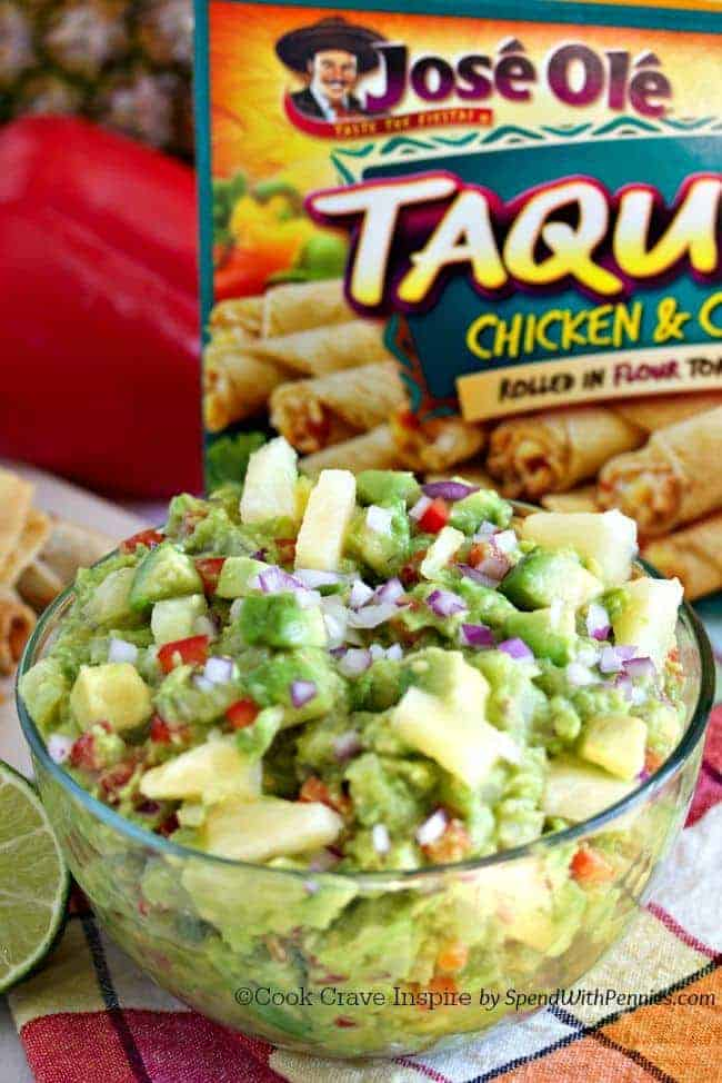 Pineapple Guacamole! Buttery avocado with fresh pineapple, cumin, onions is the perfect dip for taquitos & chips!