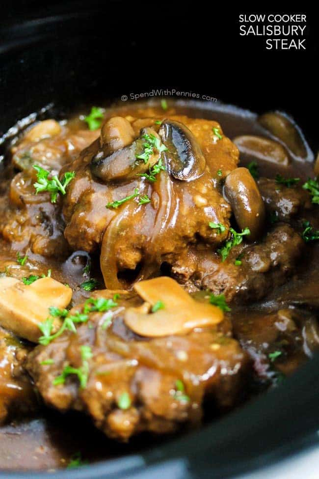 Salisbury Steak in a black crock pot with text
