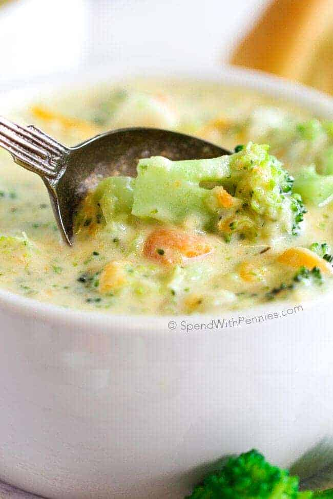 20 Minute Broccoli Cheese Soup in a white bowl with a silver spoon in it