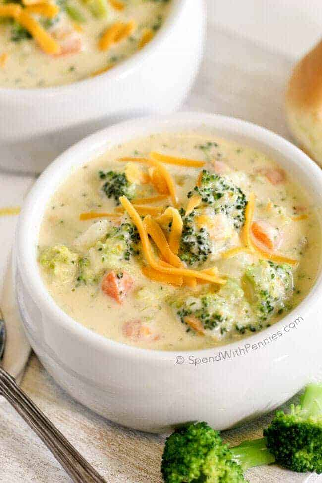 Bowls of Broccoli Cheese Soup on a table.