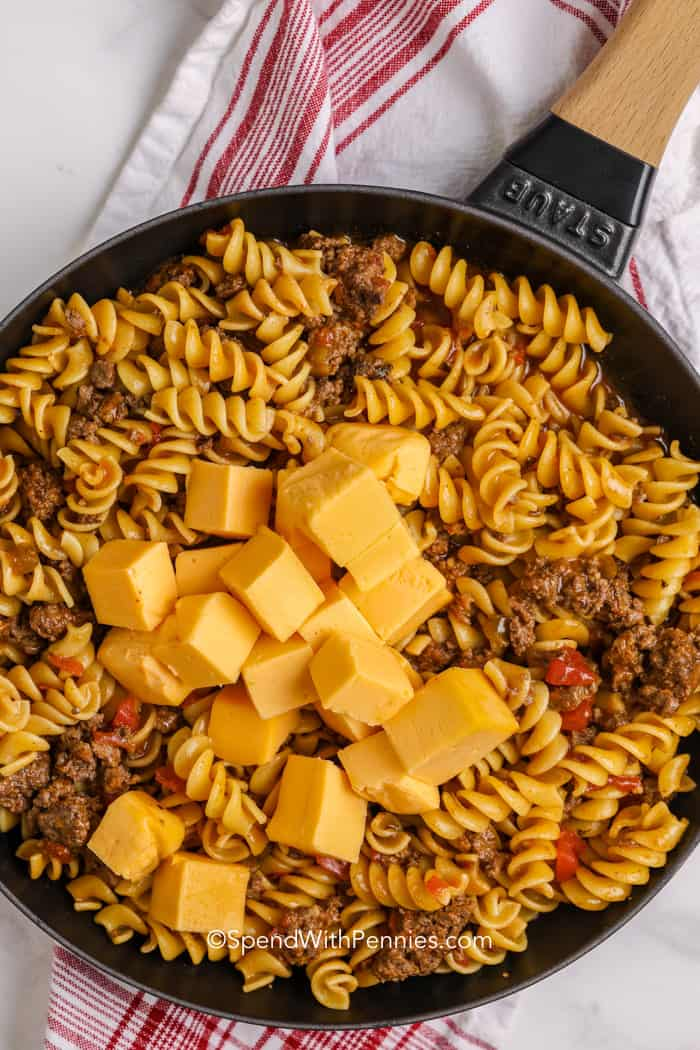 Adding Velveeta to a Cheesy taco skillet