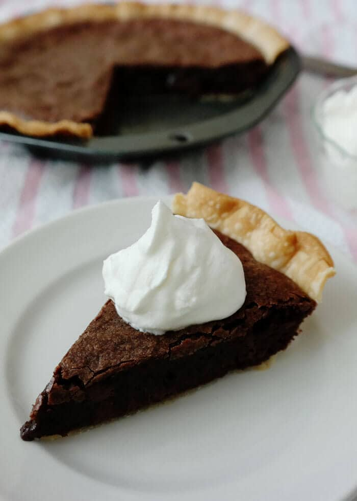Brownie Chocolate Pie is the chocolate lovers pie with a decadent fudgy brownie filling in a light flaky crust!