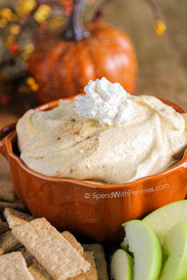 Fluffy Pumpkin Pie Dip in small orange serving dish served with apples