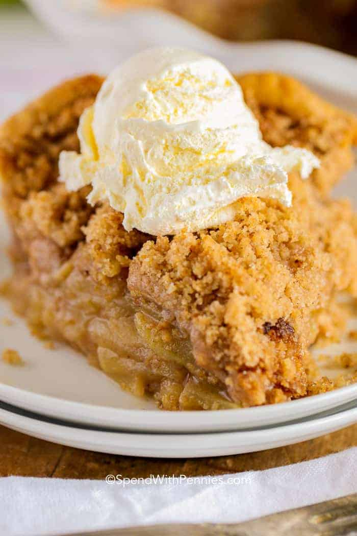 Apple Crumble Pie on a plate with vanilla ice cream