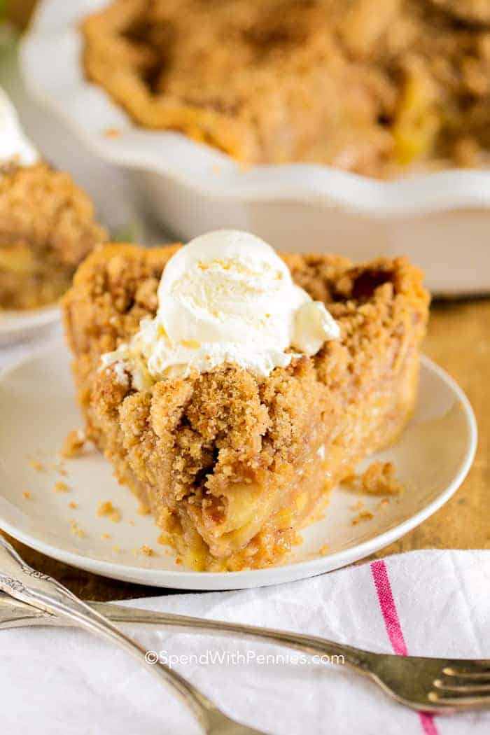 Apple Crumble Pie on a white plate with a fork