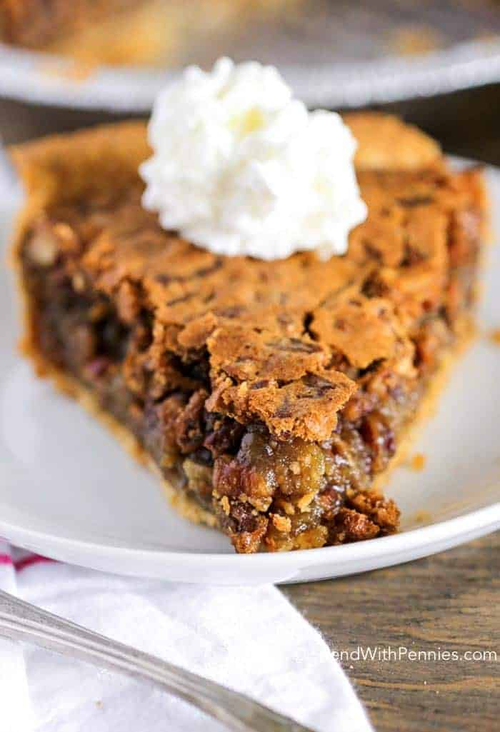 Easy Pecan Pie has a delicious gooey filling topped with pecans for the perfect holiday dessert! It's easy to make (& this recipe contains no corn syrup)!