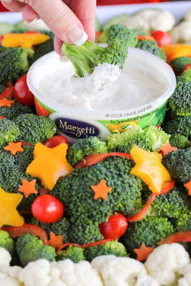 This easy veggie dip is quick to make and perfect for any holiday party! The perfect way to dress up your Christmas table and make a healthy appetizer! Find the full how to on www.spendwithpennies.com