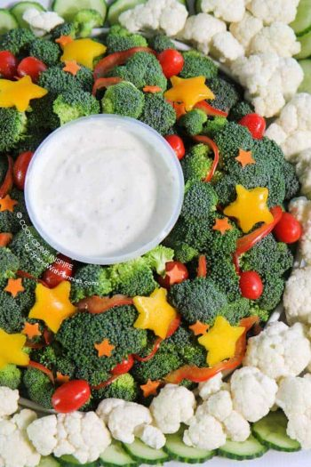A Veggie Dip shaped like a wreath with stars made of vegetables