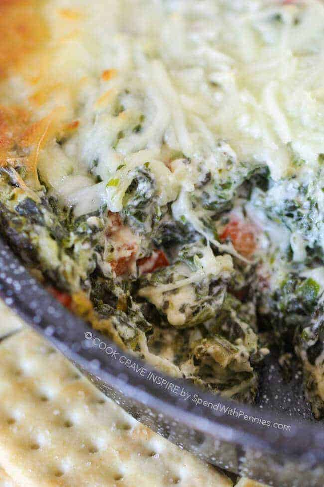 Cheesy Ranch Spinach Dip with a scoop out of it